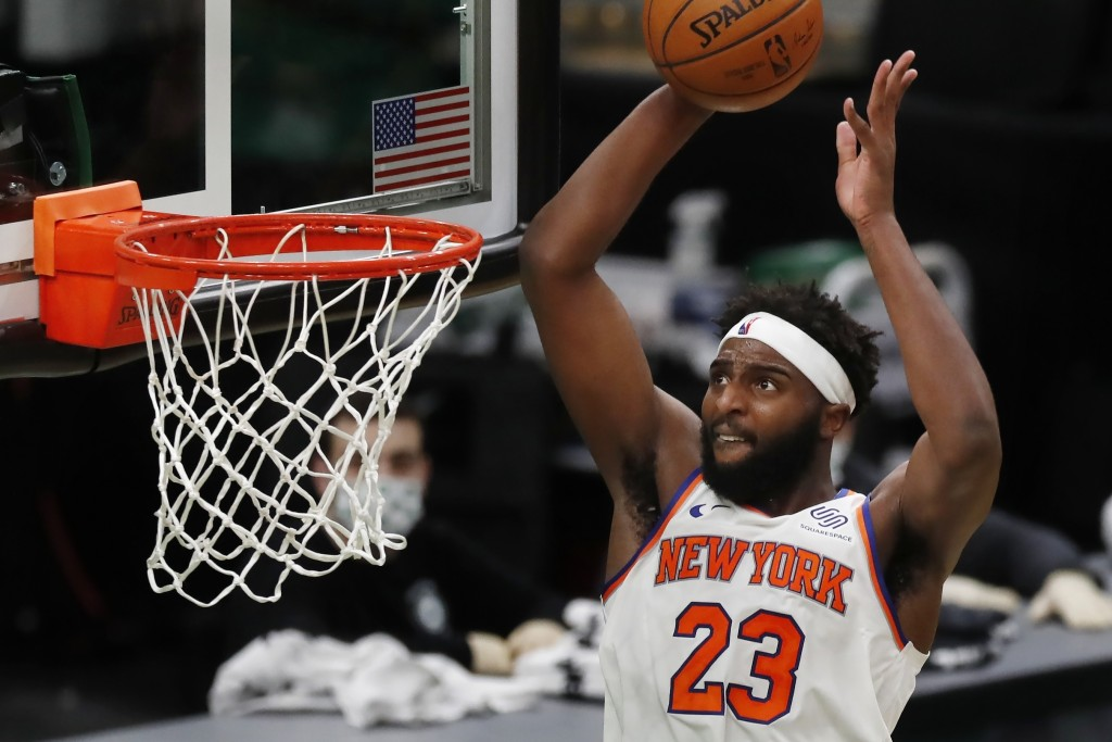 New York Knicks' Mitchell Robinson dunks during the second half of an NBA basketball game against the Boston Celtics, Sunday, Jan. 17, 2021, in Boston...