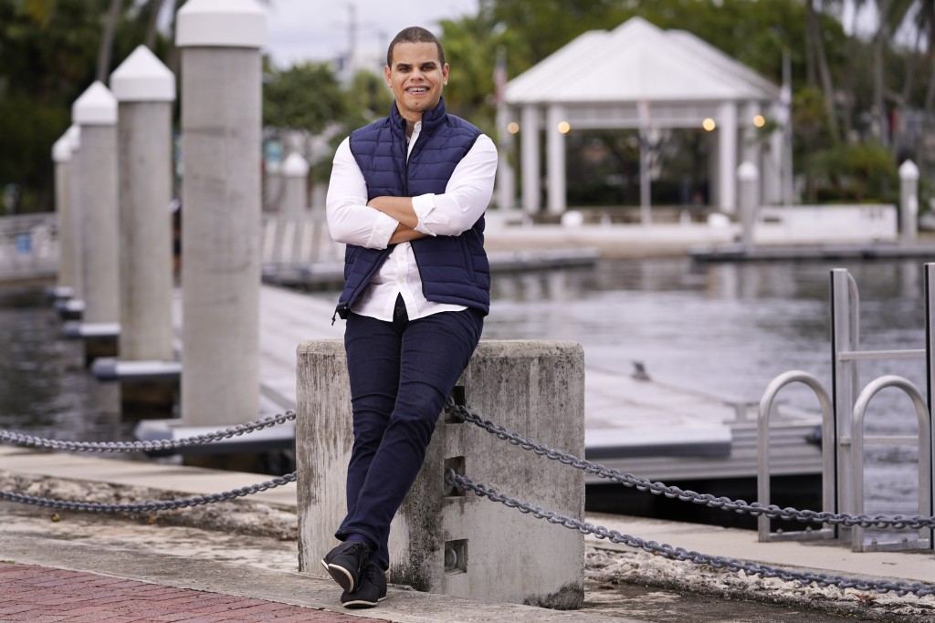 "Jason Prats poses in Fort Lauderdale, Fla., Dec. 11, 2020. Prats thinks Biden will be a ""great model"" who will restore America's character, and that R..."