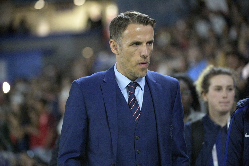 FILE - In this Wednesday, March 7, 2018 file photo, England head coach Phil Neville walks onto the field before a SheBelieves Cup women's soccer match...