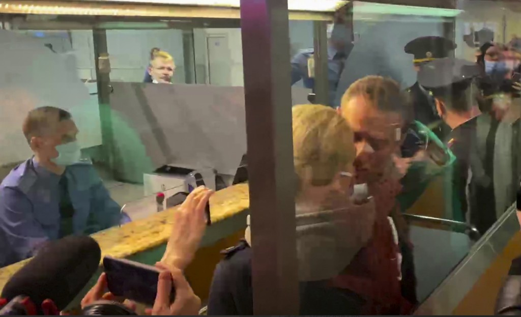 In this photo taken from video, Alexei Navalny kisses his wife Yulia as he is detained by police at the passport control after arriving at Sheremetyev...