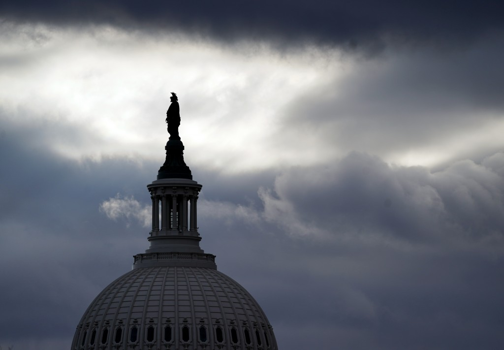 The Statue of Freedom by Thomas Crawford, atop the dome of the U.S. Capitol, is shown ahead of the inauguration of President-elect Joe Biden and Vice ...