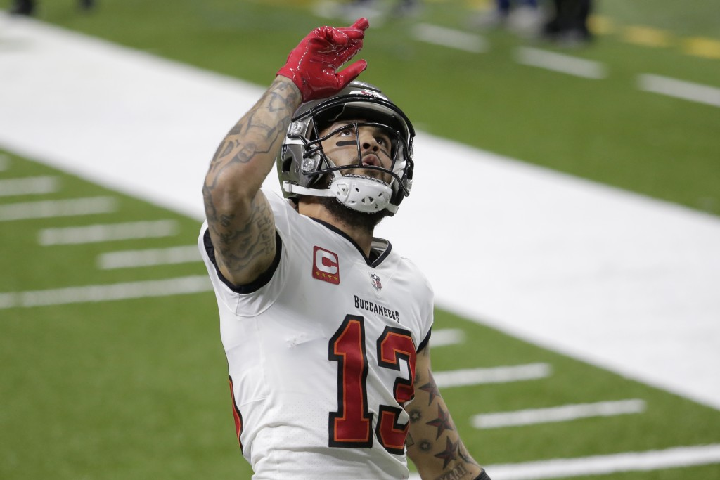 Tampa Bay Buccaneers wide receiver Mike Evans (13) celebrates his touchdown against the New Orleans Saints during the first half of an NFL divisional ...