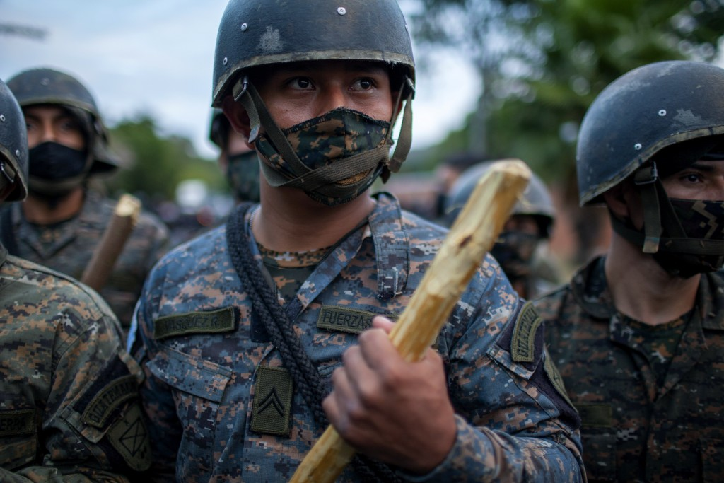 Guatemalan soldiers block part of a Honduran migrant caravan in their bid to reach the U.S. border, in Vado Hondo, Guatemala, Sunday, Jan. 17, 2021.(A...