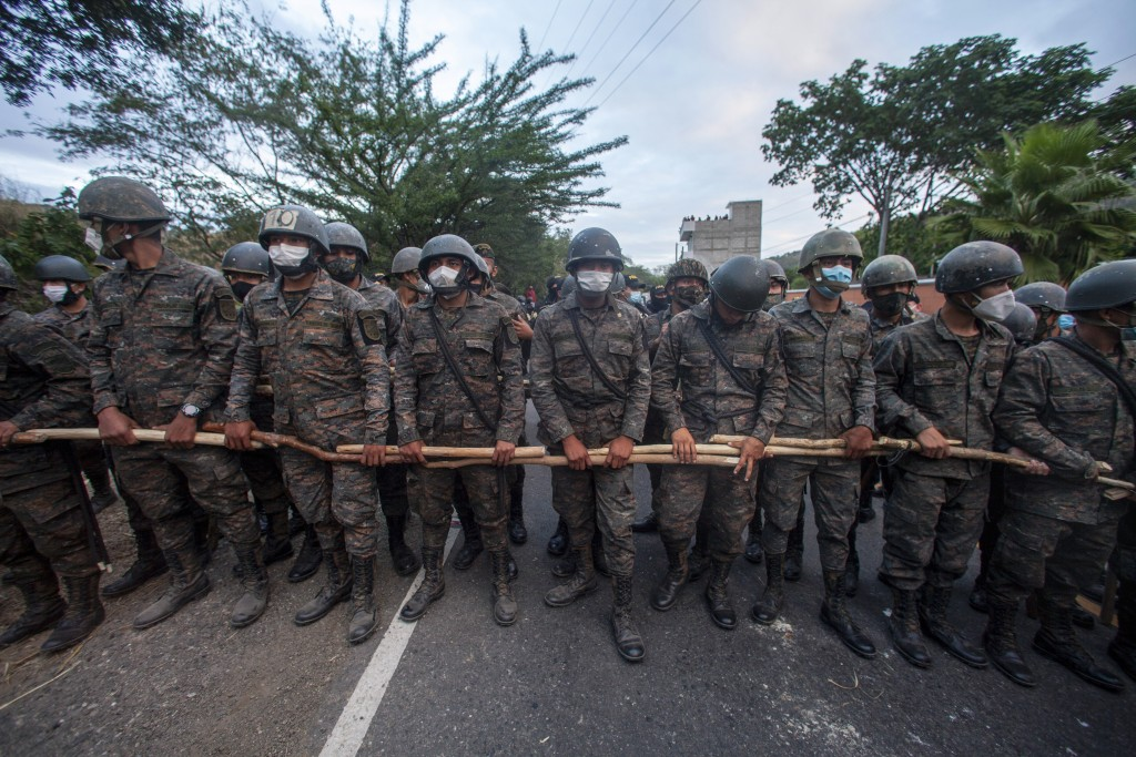 Guatemalan soldiers block part of a Honduran migrant caravan in their bid to reach the U.S. border, in Vado Hondo, Guatemala, Sunday, Jan. 17, 2021. (...