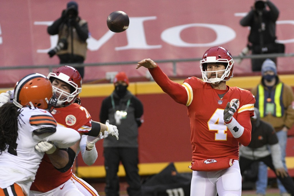 Kansas City Chiefs quarterback Chad Henne throws a pass during the second half of an NFL divisional round football game against the Cleveland Browns, ...