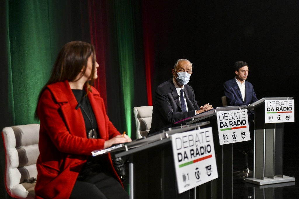 Portuguese President Marcelo Rebelo de Sousa, center, who is seeking a second term in the country's presidential election on Jan. 24, participates in ...