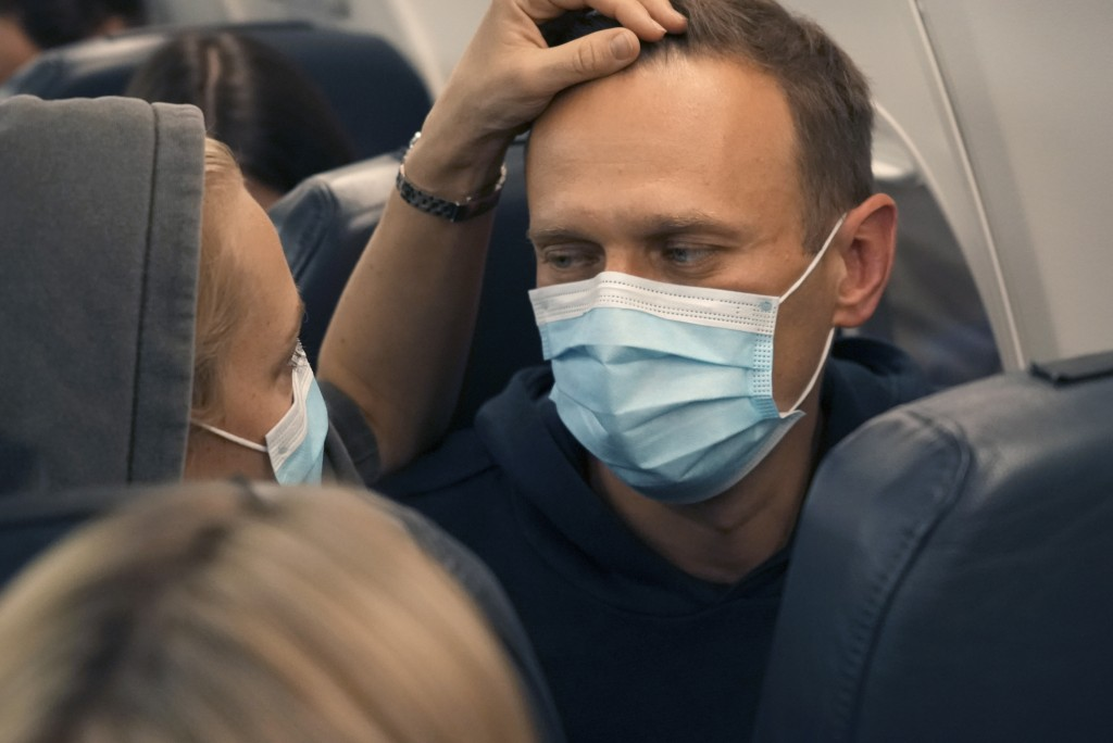 Alexei Navalny and his wife Yulia sit on the plane on a flight to Moscow, at the Airport Berlin Brandenburg (BER) in Schoenefeld, near Berlin, Germany...