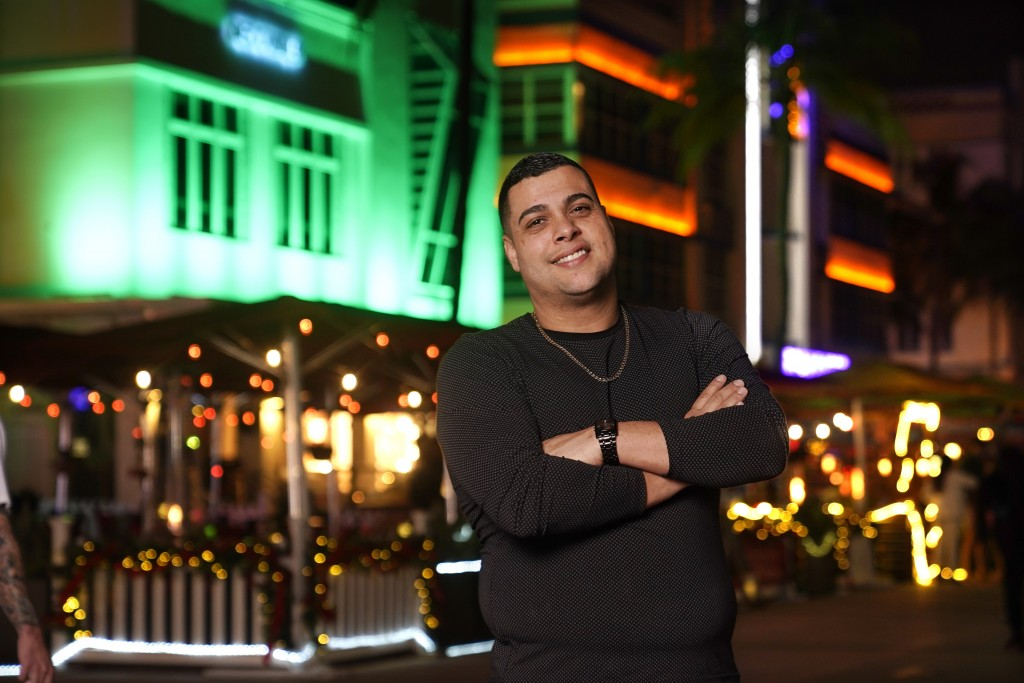 Frank Ayllon poses in Miami Beach, Fla., Dec. 10, 2020. Ayllon, a 37-year-old food services consultant in Miami, credits Trump with dispelling politic...