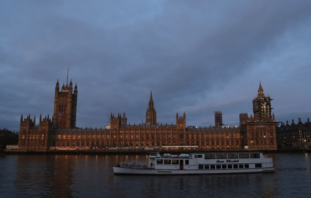 The Palace of Westminster viewed from the south side of the embankment by the River Thames just after dawn in London, Monday, Jan. 18, 2021. (AP Photo...