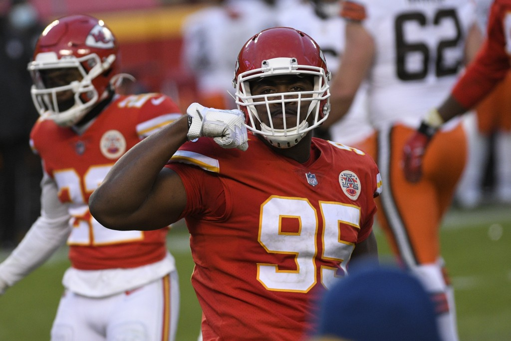 Kansas City Chiefs defensive tackle Chris Jones celebrates during the second half of an NFL divisional round football game against the Cleveland Brown...