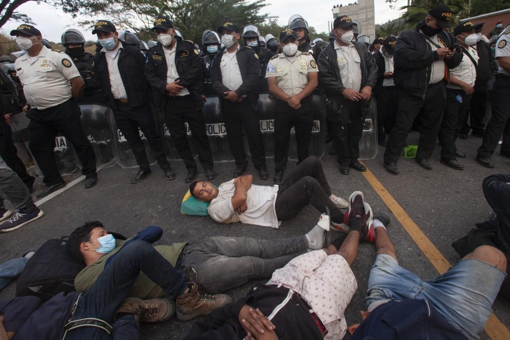 Guatemalan police agents block part of a Honduran migrant caravan in their bid to reach the U.S. border, in Vado Hondo, Guatemala, Sunday, Jan. 17, 20...