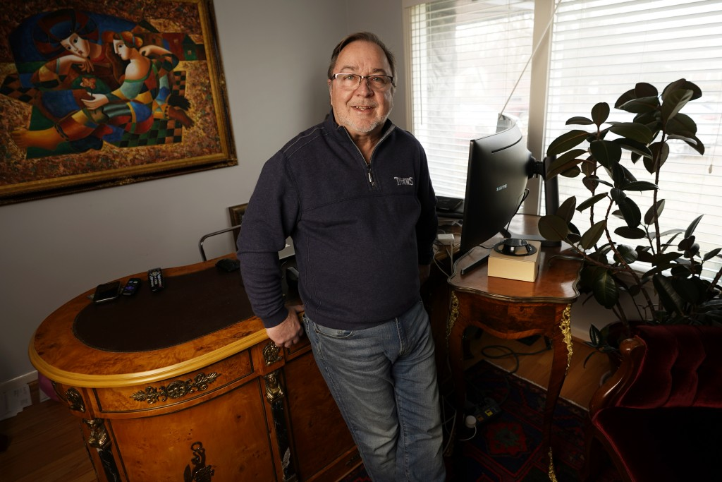 Kenneth Eaton, a day trader, poses in his home office in Franklin, Tenn., Jan. 14, 2021. Eaton, a 63-year-old Nashville businessman, was proud to serv...