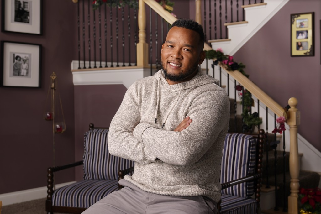 "Bobby Mitchell poses in his home in Canal Winchester, Ohio, Dec. 19, 2020. He praises Trump for ""taking care of Americans first in every trade deal,"" ..."