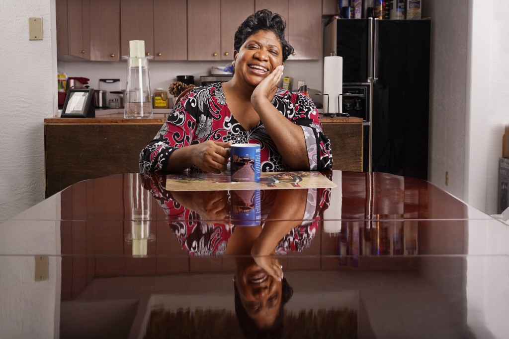 Latricia Robinson poses in her apartment in St. Petersburg, Fla., Dec. 9, 2020. The election of Biden and Harris has made her hopeful, as have the res...