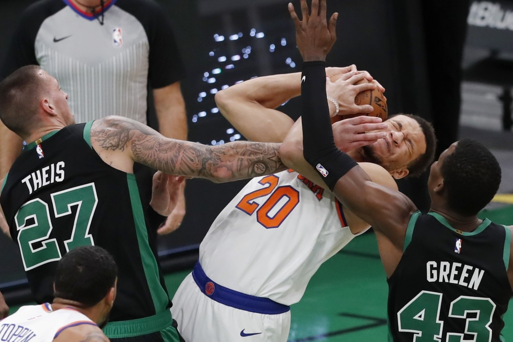 Boston Celtics' Daniel Theis (27) and Javonte Green (43) battle New York Knicks' Kevin Knox II (20) for a rebound during the first half of an NBA bask...