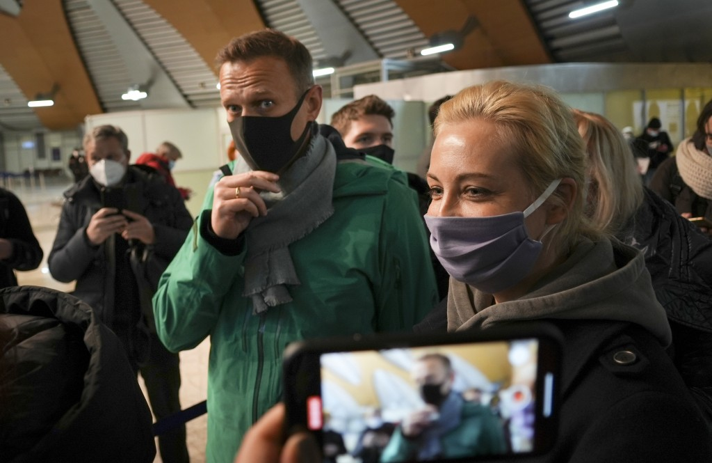 Alexei Navalny and his wife Yuliastand in line at the passport control after arriving at Sheremetyevo airport, outside Moscow, Russia, Sunday, Jan. 17...