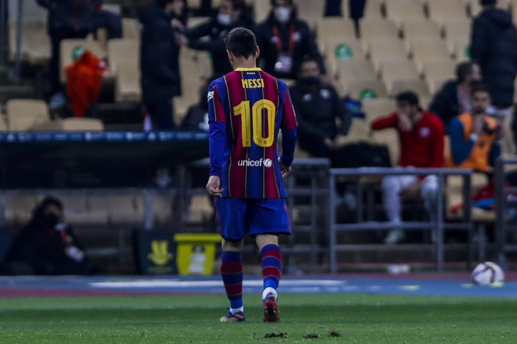 Barcelona's Lionel Messi walks out of the pitch after being shown a red card during the Spanish Supercopa final soccer match against FC Barcelona at L...