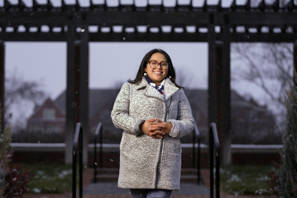 Cynthia Morraz poses on the campus of Indiana University-Purdue University in Indianapolis, Dec. 16, 2020. Morraz a 26-year-old student volunteered to...