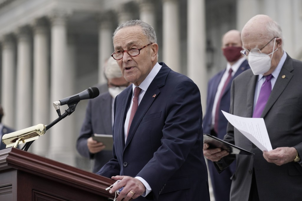 FILE - In this Oct. 22, 2020, file photo Senate Minority Leader Chuck Schumer, D-N.Y., and Democratic members of the Senate Judiciary Committee hold a...