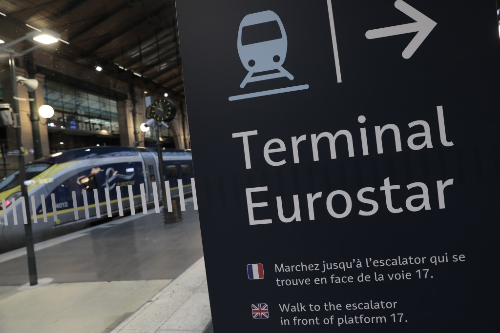 FILE - In this Dec.21, 2020 file photo, an information board is displayed at Gare du Nord train station in Paris. The chief of France's state rail the...