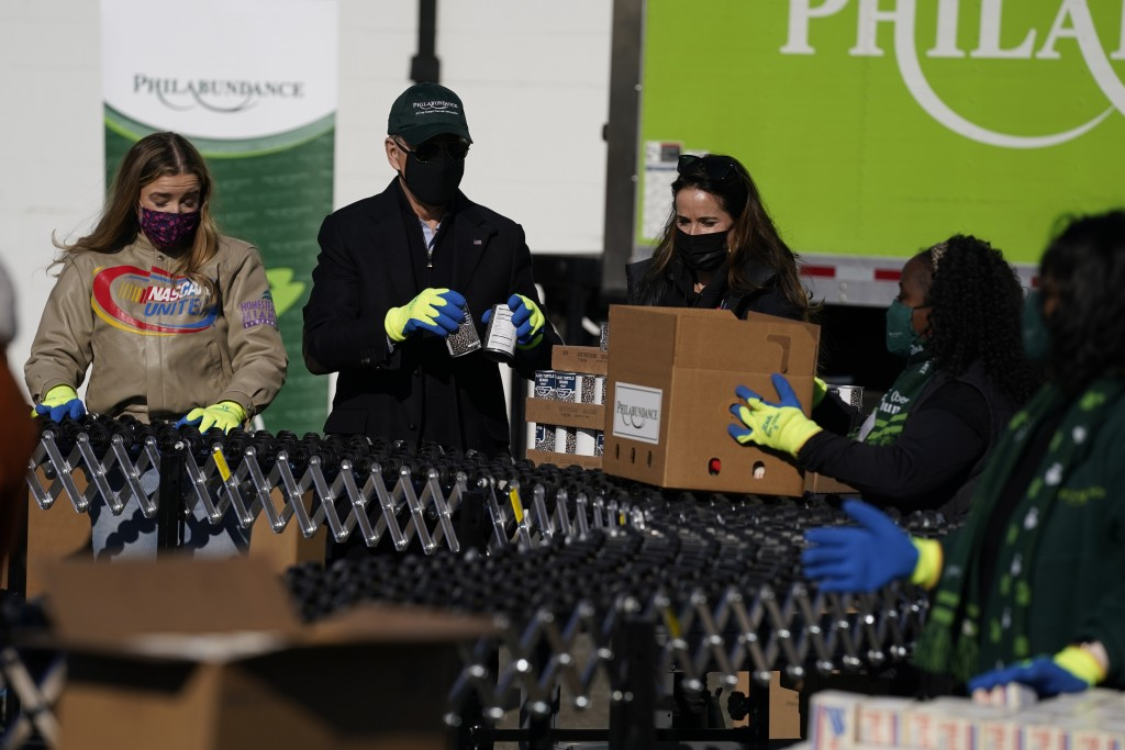 President-elect Joe Biden participates in a National Day of Service event at Philabundance, a hunger relief organization, with his daughter Ashley Bid...