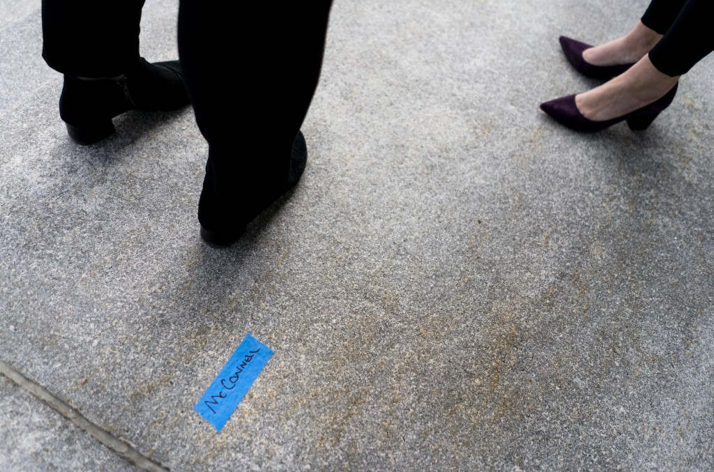 On the East side of the U.S. Capitol, a piece of tape marks the name McConnell as people participate in a rehearsal for the 59th inaugural ceremony fo...
