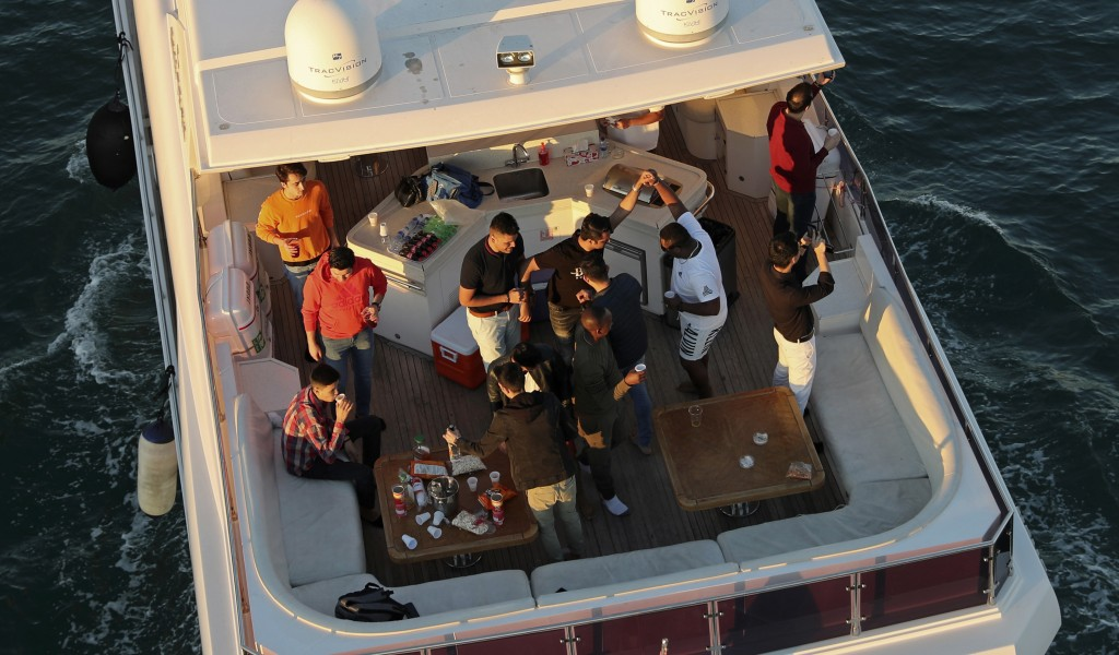 Tourists party on a yacht in Dubai, United Arab Emirates, Tuesday, Jan. 12, 2021. Since becoming one of the world's first destinations to open up for ...