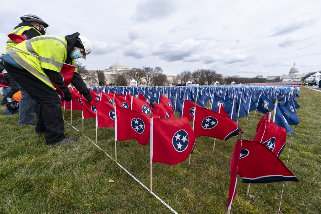 State flags including the Tennessee state flag, in front, are placed on the National Mall ahead of the inauguration of President-elect Joe Biden and V...