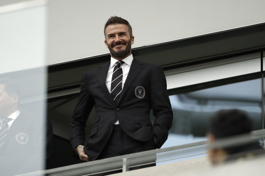 FILE - David Beckham looks on from the stands before an MLS soccer match between Los Angeles FC and Inter Miami CF in Los Angeles, in this Sunday, Mar...