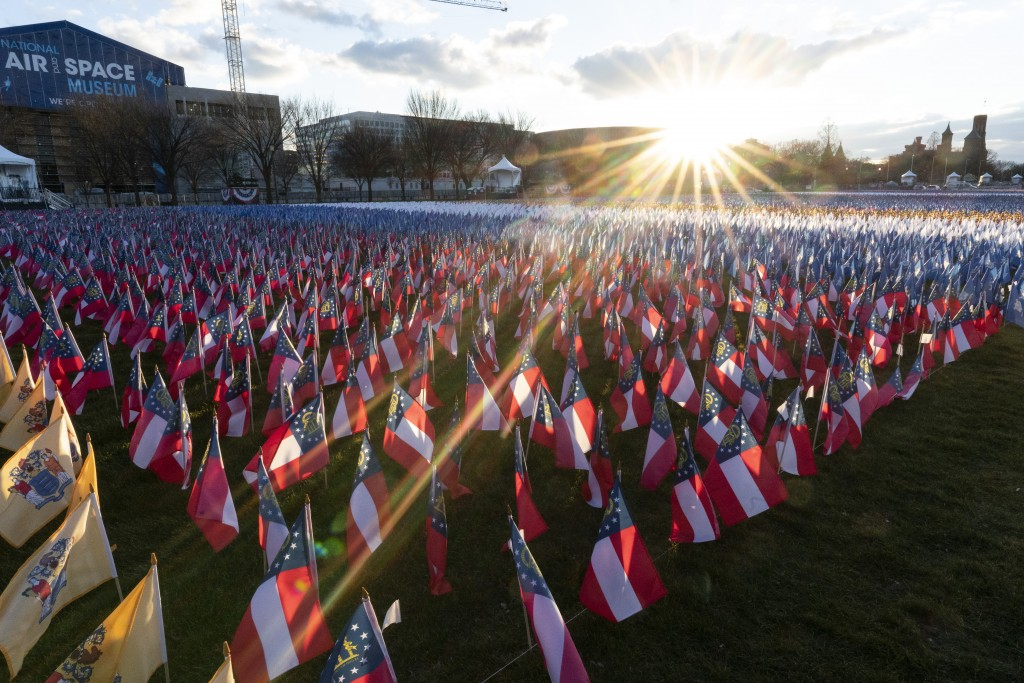 Flags are placed on the National Mall ahead of the inauguration of President-elect Joe Biden and Vice President-elect Kamala Harris, Monday, Jan. 18, ...