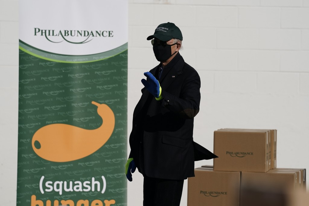 President-elect Joe Biden waves as he leaves after participating in a National Day of Service event at Philabundance, a hunger relief organization, Mo...