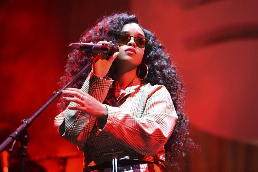 FILE - H.E.R. performs at the Spotify Best New Artist 2019 Party in Los Angeles on Feb. 7, 2019. R&B star Jazmine Sullivan and country singer Eric Chu...