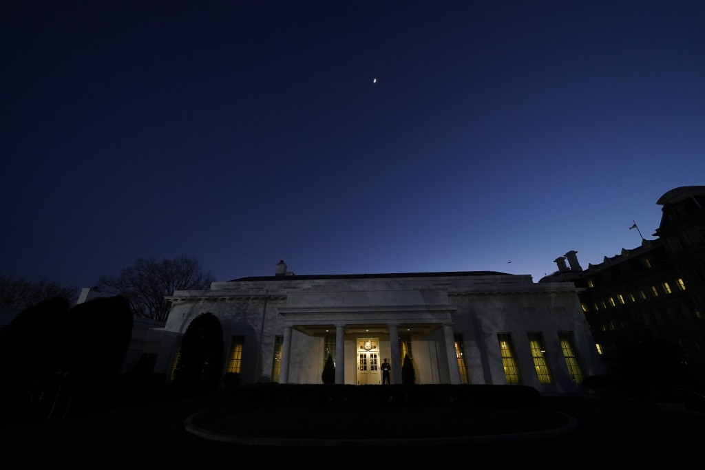 The moon rises over the West Wing of the White House, on President Donald Trump's last day in office, Tuesday, Jan. 19, 2021, in Washington. The Marin...