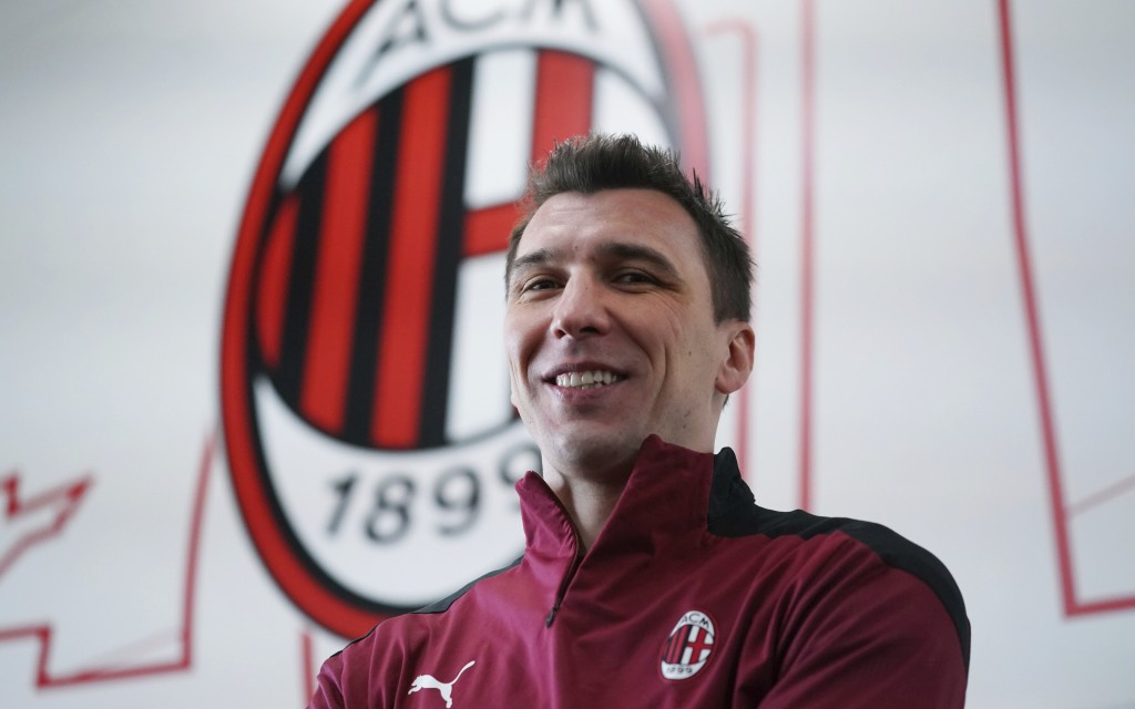 Mario Mandzukic poses at the Milanello Milan's sport center prior to his first training session, in Carnago, Italy, Tuesday, Jan. 19, 2021. AC Milan h...