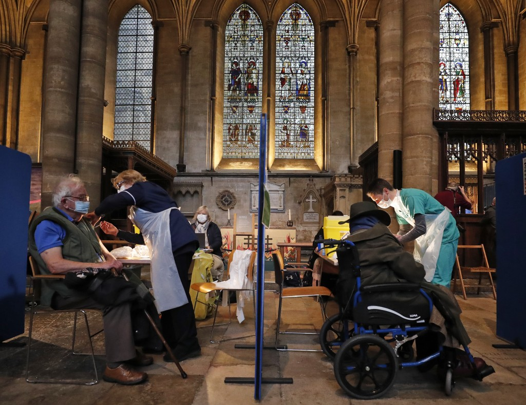 People recieve their Pfizer-BioNTech vaccination inside Salisbury Cathedral in Salisbury, England, Wednesday, Jan. 20, 2021. Salisbury Cathedral opene...