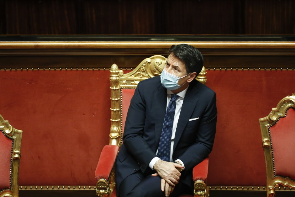 Italian Prime Minister Giuseppe Conte attends the debate at the Senate prior to a confidence vote, in Rome, Tuesday, Jan. 19, 2021. Italian Premier Gi...