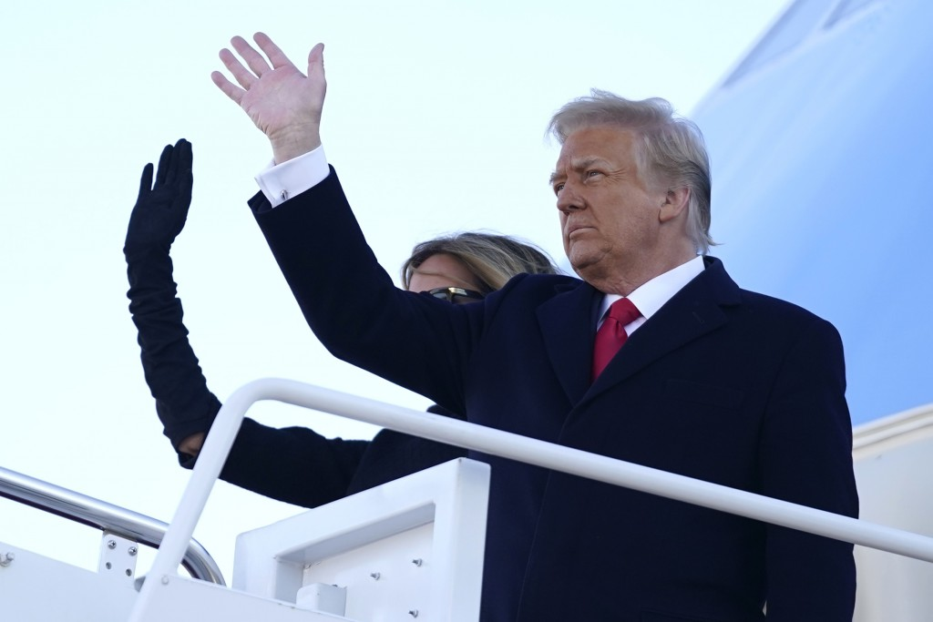 President Donald Trump and first lady Melania Trump board Air Force One at Andrews Air Force Base, Md., Wednesday, Jan. 20, 2021.(AP Photo/Manuel Balc...
