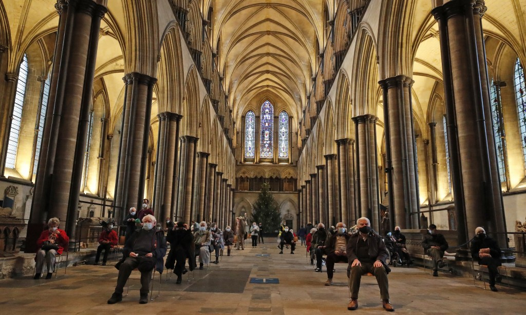 People sit and relax after receiving their Pfizer-BioNTech vaccination at Salisbury Cathedral in Salisbury, England, Wednesday, Jan. 20, 2021. Salisbu...