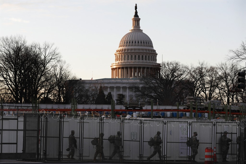 National Guards deploy inside the security perimeter surrounding the Capitol ahead of President-elect Joe Biden's inauguration ceremony, Tuesday, Jan....