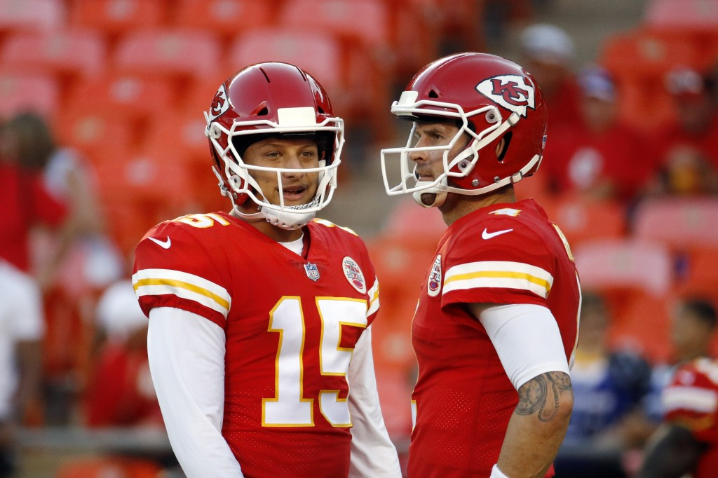 FILE - Kansas City Chiefs quarterback Chad Henne, right, chats with quarterback Patrick Mahomes (15) before an NFL preseason football game against the...