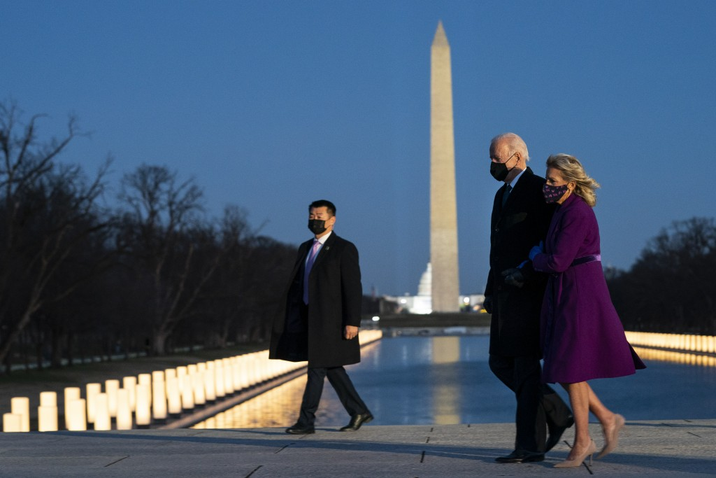 President-elect Joe Biden and his wife Jill Biden leave a COVID-19 memorial event at the Lincoln Memorial Reflecting Pool, Tuesday, Jan. 19, 2021, in ...