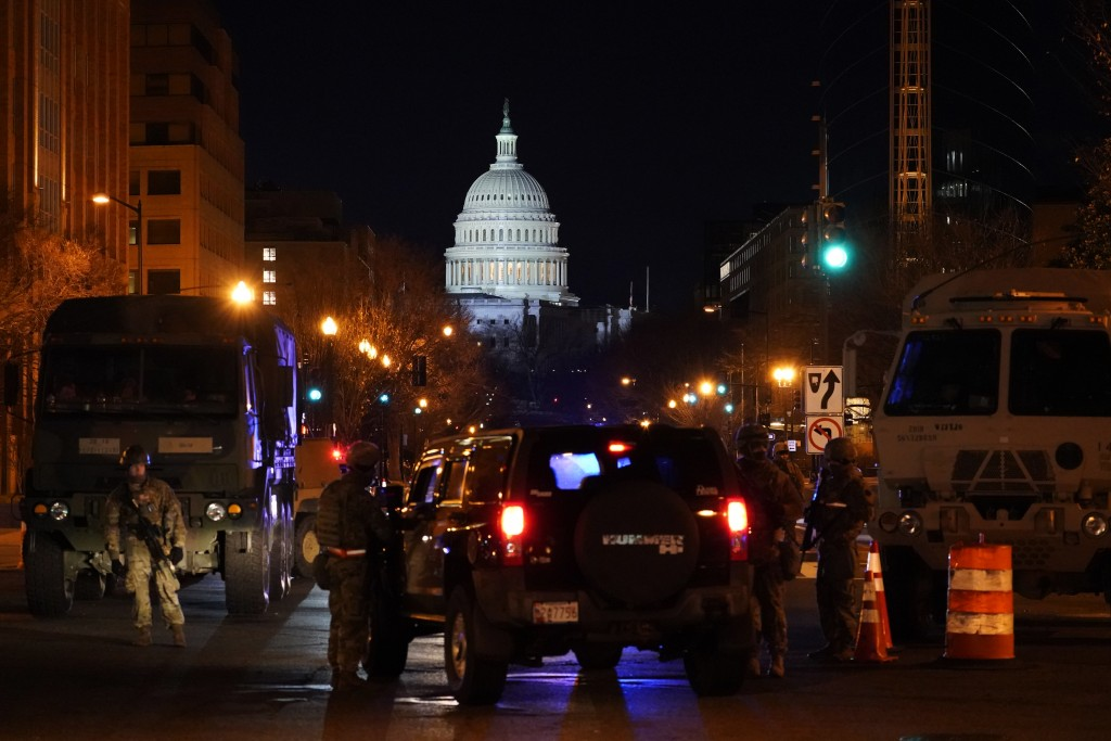 National Guard check vehicles at a road block near the Capitol ahead President-elect Joe Biden's inauguration ceremony, Tuesday, Jan. 19, 2021, in Was...
