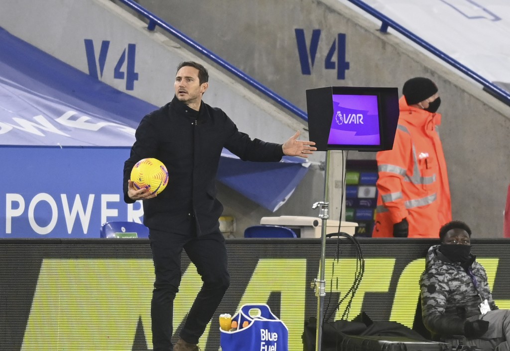 Chelsea's head coach Frank Lampard waits for the VAR system to be reviewed by the referee during the English Premier League soccer match between Leice...