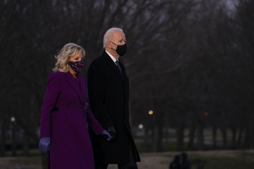 President-elect Joe Biden and his wife Jill Biden arrive for a COVID-19 memorial event at the Lincoln Memorial Reflecting Pool, Tuesday, Jan. 19, 2021...