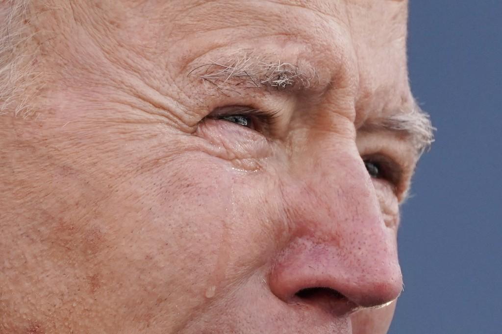 "President-elect Joe Biden tears up as he speaks at the Major Joseph R. ""Beau"" Biden III National Guard/Reserve Center, Tuesday, Jan. 19, 2021, in New ..."