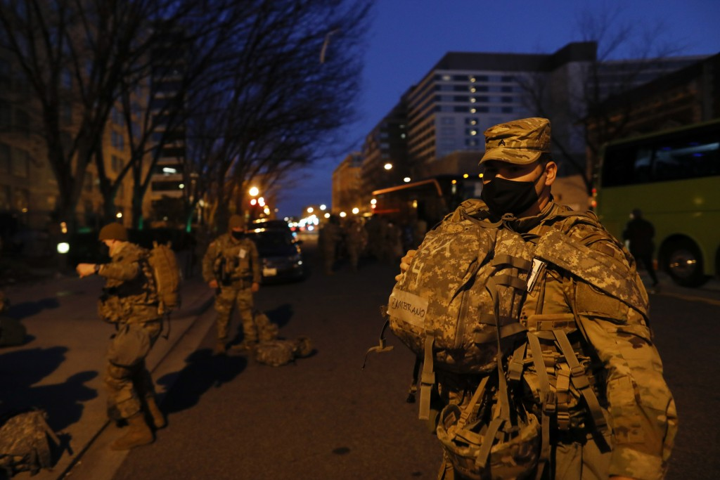 National Guard troops deploy near the Capitol at dawn in preparation for President-elect Joe Biden's inauguration ceremony, Tuesday, Jan. 19, 2021, in...