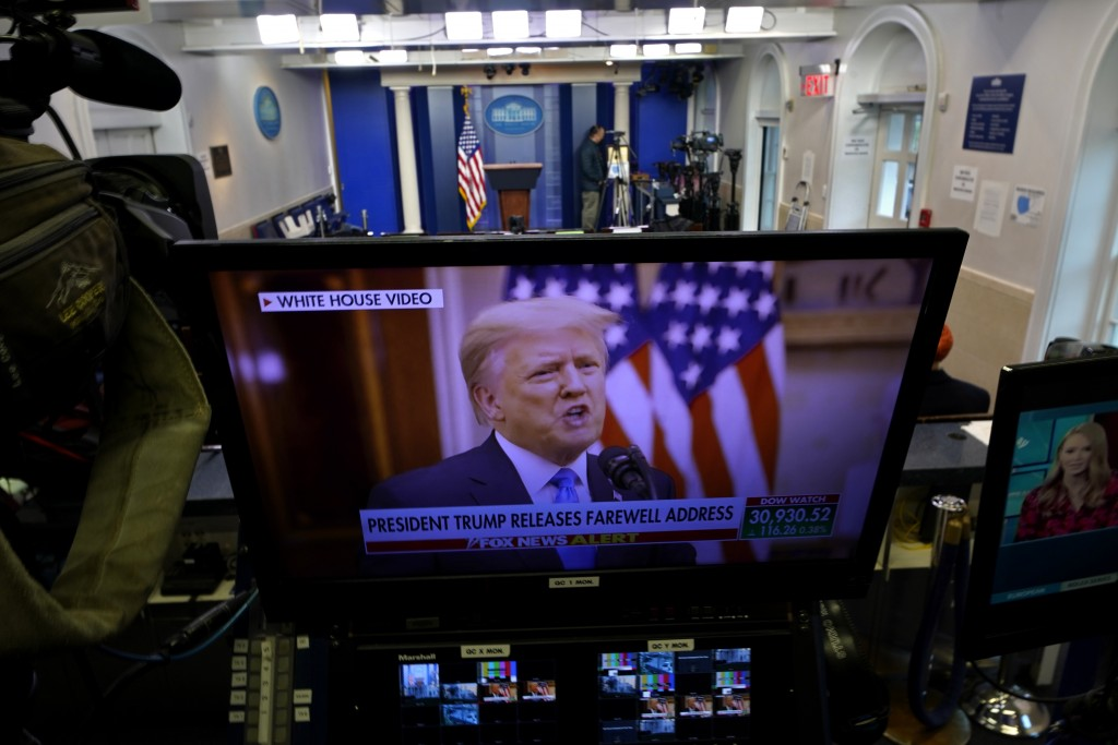 President Trump is seen on a network monitor after his pre-recorded farewell speech was released, inside the Brady Press Briefing Room at the White Ho...
