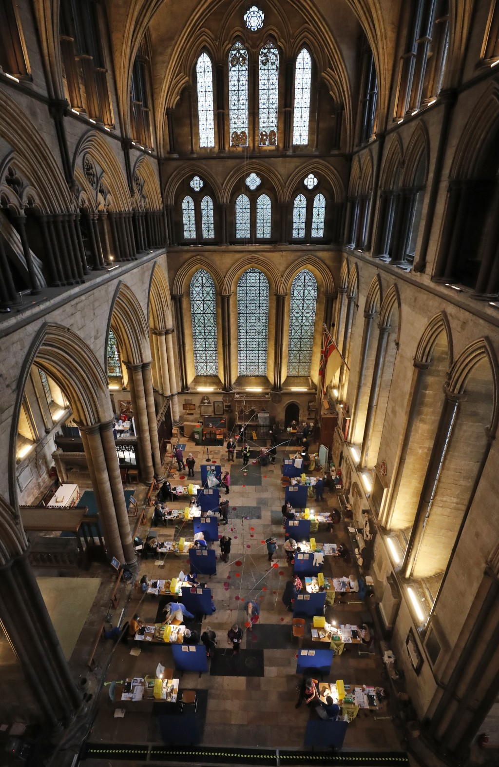 Fourteen tables are set up to provide the Pfizer-BioNTech vaccine inside Salisbury Cathedral in Salisbury, England, Wednesday, Jan. 20, 2021. Salisbur...