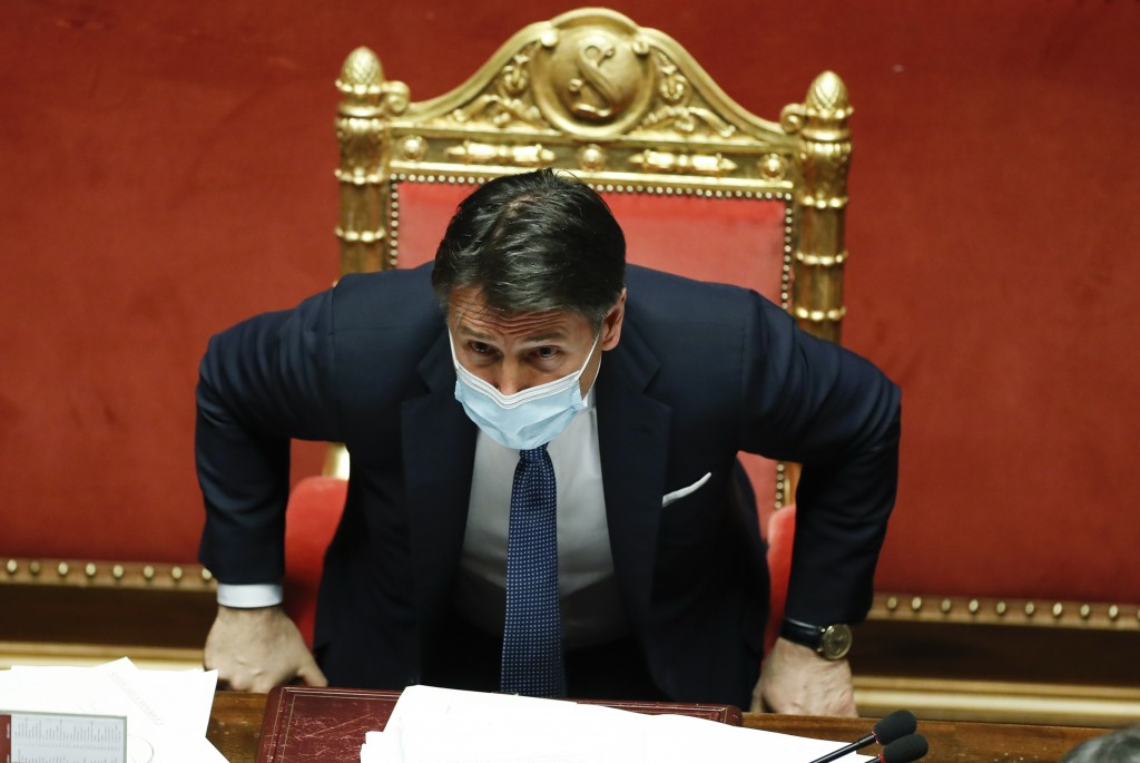 Italian Prime Minister Giuseppe Conte sits after his final address at the Senate prior to a confidence vote, in Rome, Tuesday, Jan. 19, 2021. Italian ...