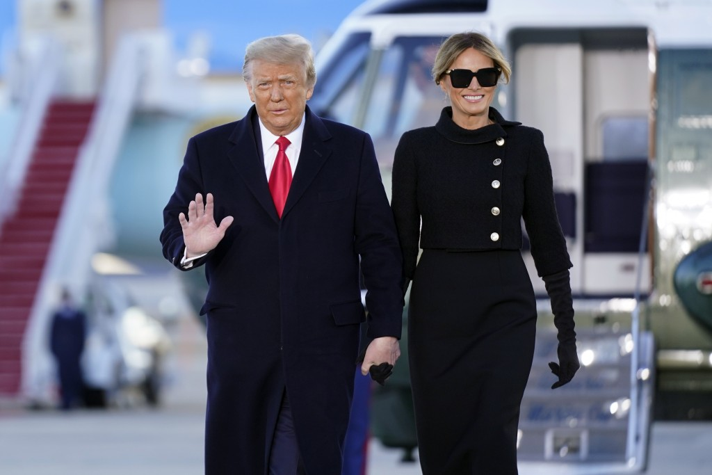 President Donald Trump and first lady Melania Trump arrive on Marine One before boarding Air Force One at Andrews Air Force Base, Md., Wednesday, Jan....